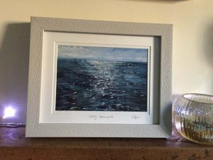 Photo of framed print of sparkling seas